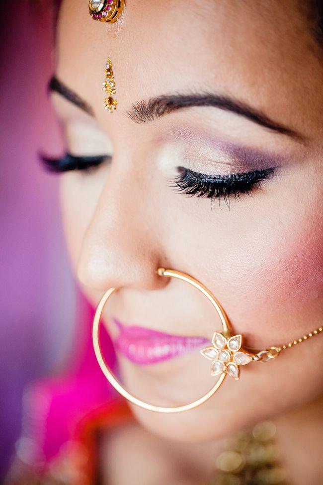 Closeup of Indian bride makeup and gold round nose ring nath ...