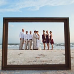 This lovely beach wedding in Florida is like the 101 on using frames as props for wedding pics