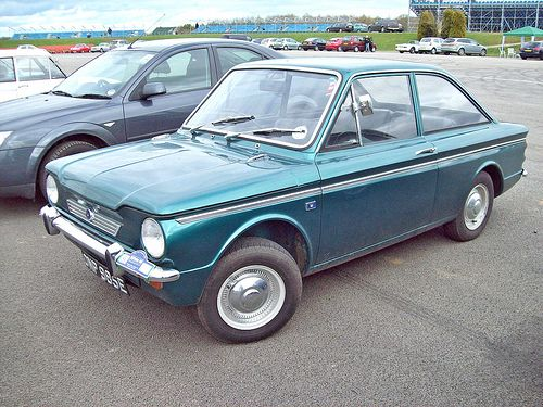 Hillman Imp 875, paid $50 for it and rebuilt it from jc