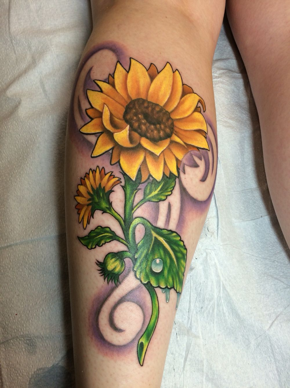 My sunflower tattoo by Eric Hayes at Pikes Peak Tattoo in