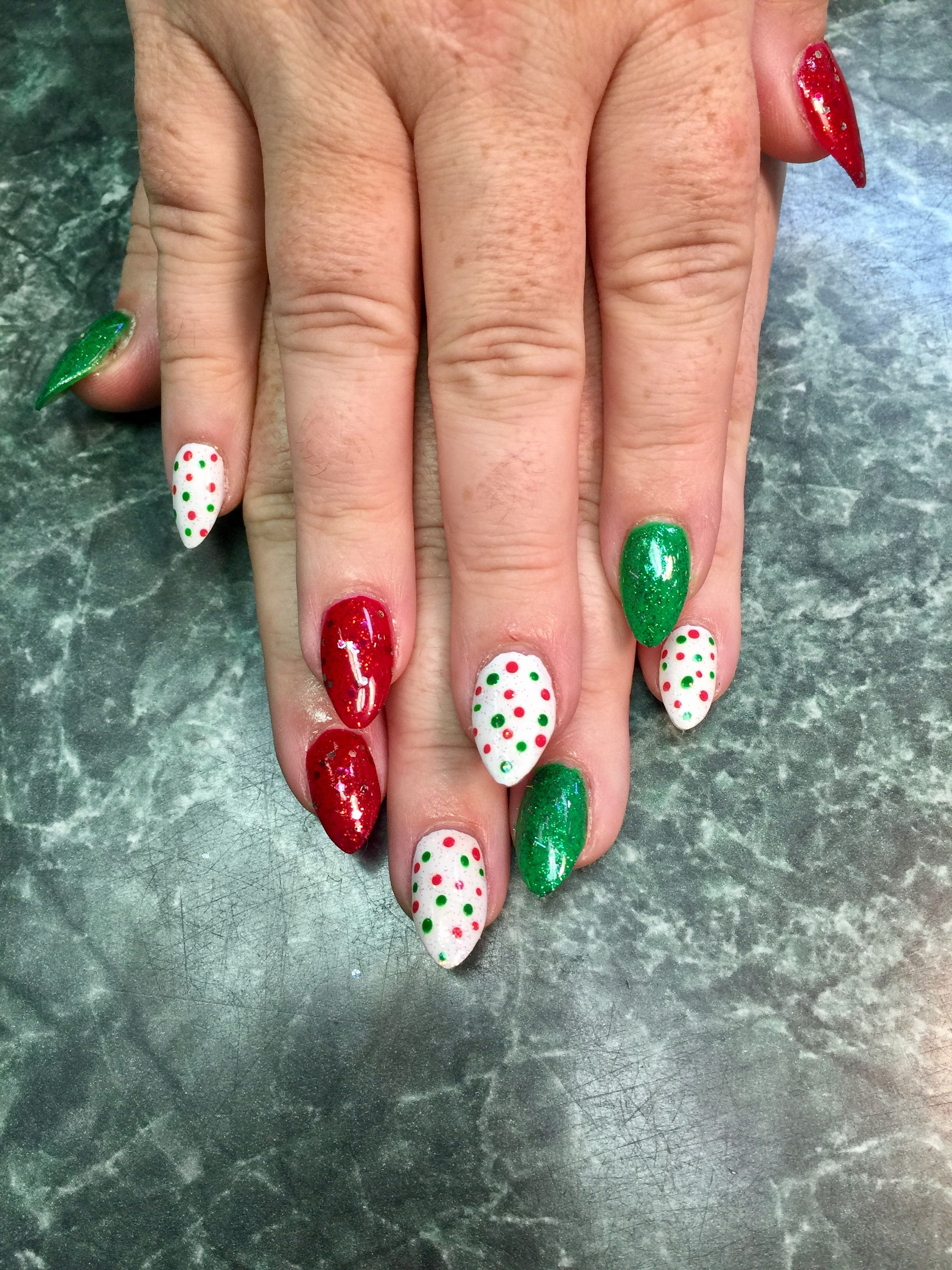 Red, green, white, and polka dot Christmas nails