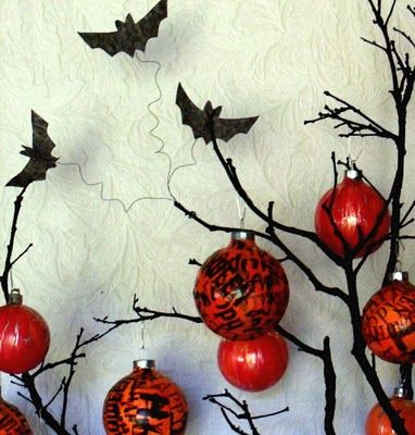 Halloween tissue paper decoupaged over Christmas balls Christmas