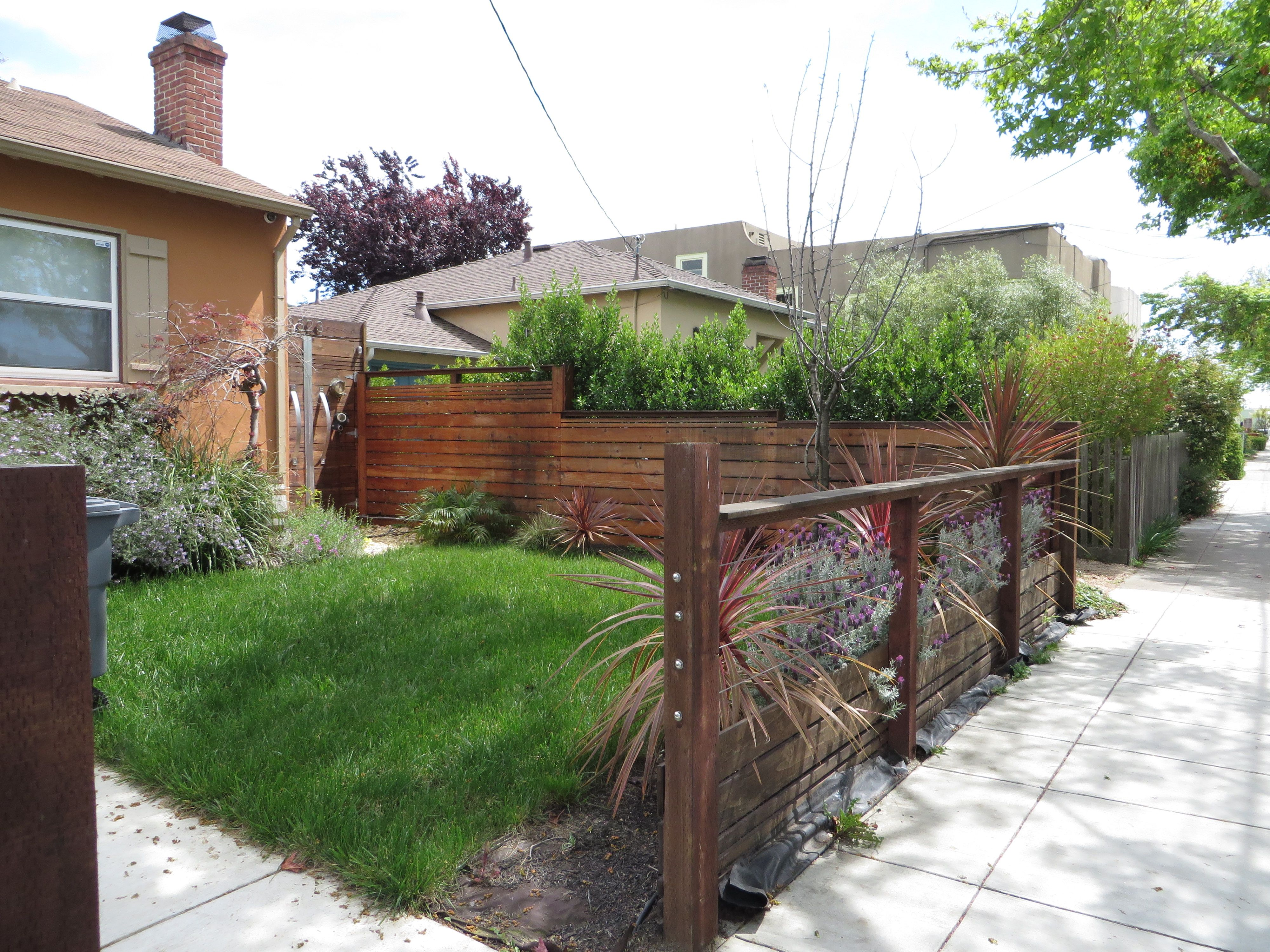 modern low fence with wood at bottom horizontal wires and nice