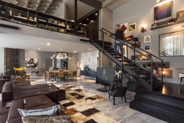 Loft einrichtung offener wohnbereich schwarze treppe for Wohnungen inneneinrichtung