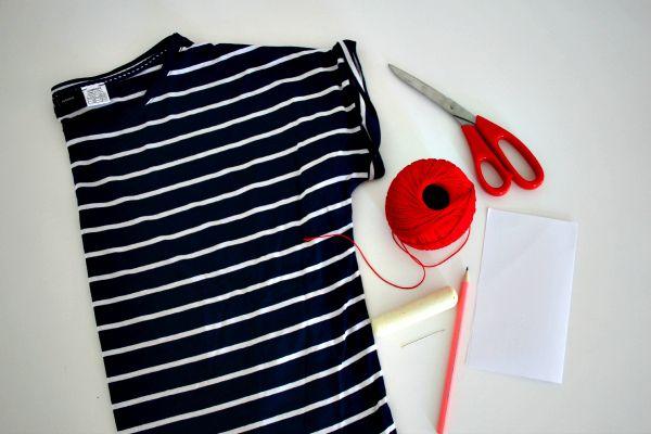 DIY / MARINIERE 1 marinière – ici, la marinière R Essentiel 1 paire de ciseaux Du fil de coton rouge 1 craie 1 aiguille à laine 1 feuille de papier 1 crayon