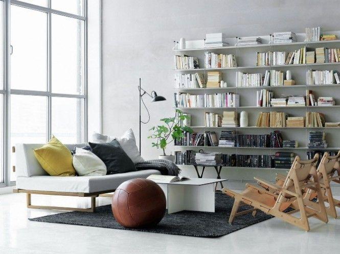 living room with a large bookshelf. #livingroom   interior