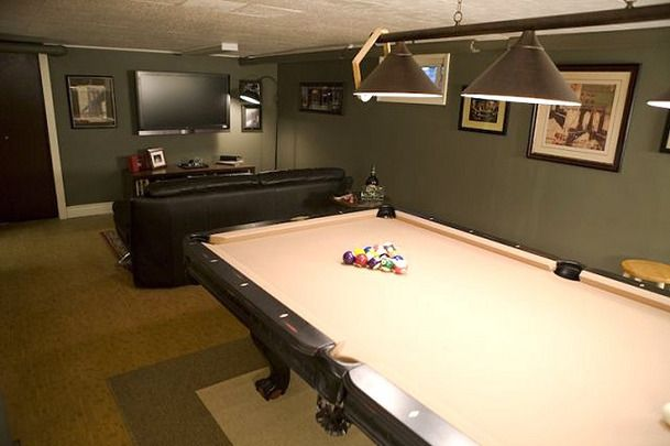 This Man Cave Features A Pool Table And Prime Seating For Watching - Pool table seating