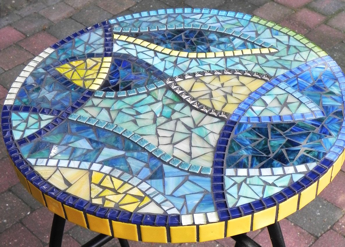 This stylish mosaic table is made of hand cutted stained glass ...