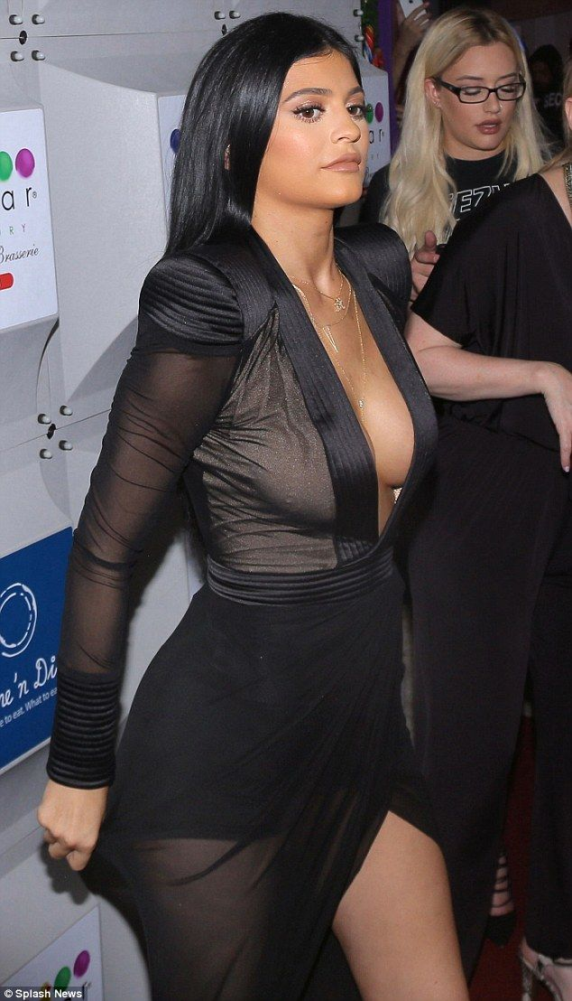 1119fb913c Kylie Jenner copies Kim in plunging black gown at Miami store opening