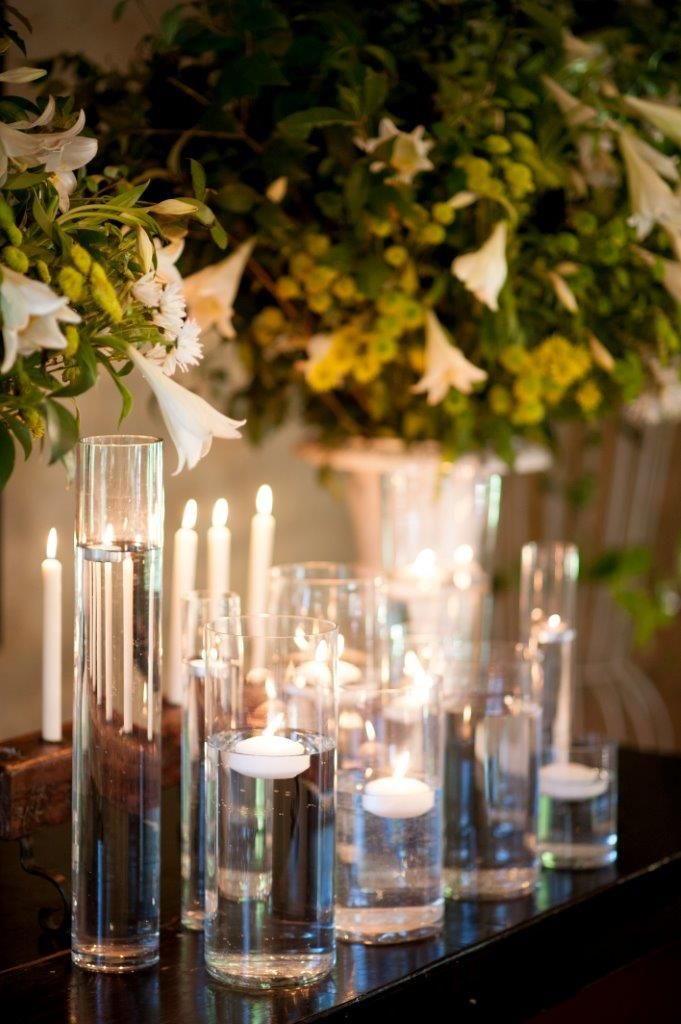 Floating Candles In Assorted Glass Vases Chapels And Churches