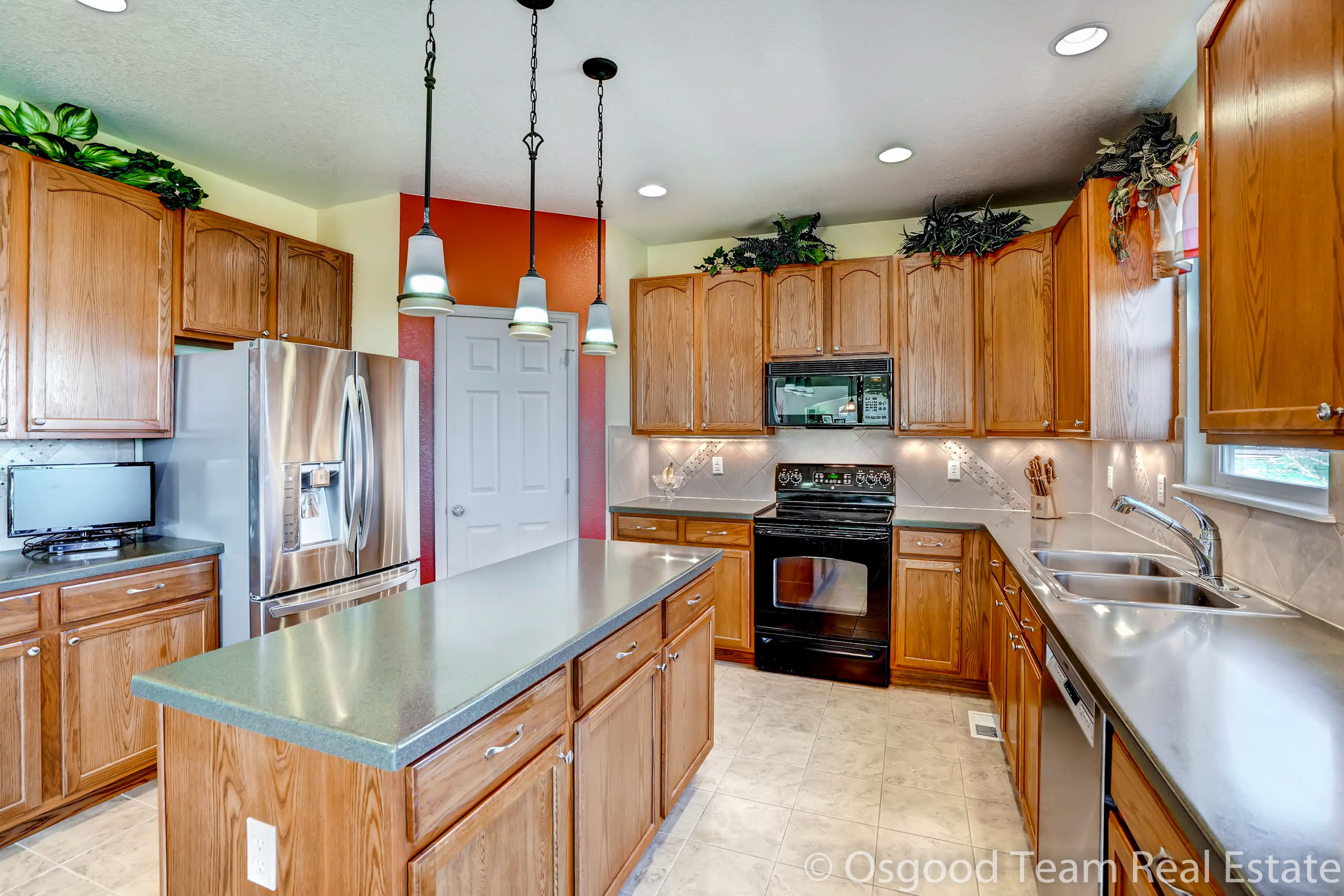 open kitchen with large center island pendant lights and abundance