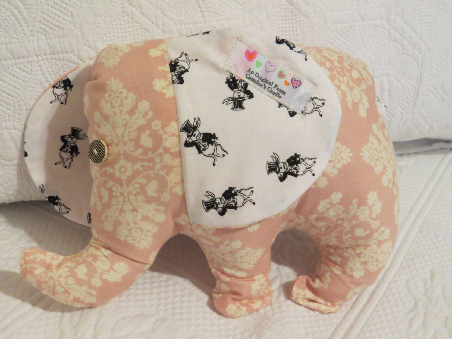 A personal favorite from my Etsy shop https://www.etsy.com/listing/244448832/eleanor-elephant-cotton-rattle