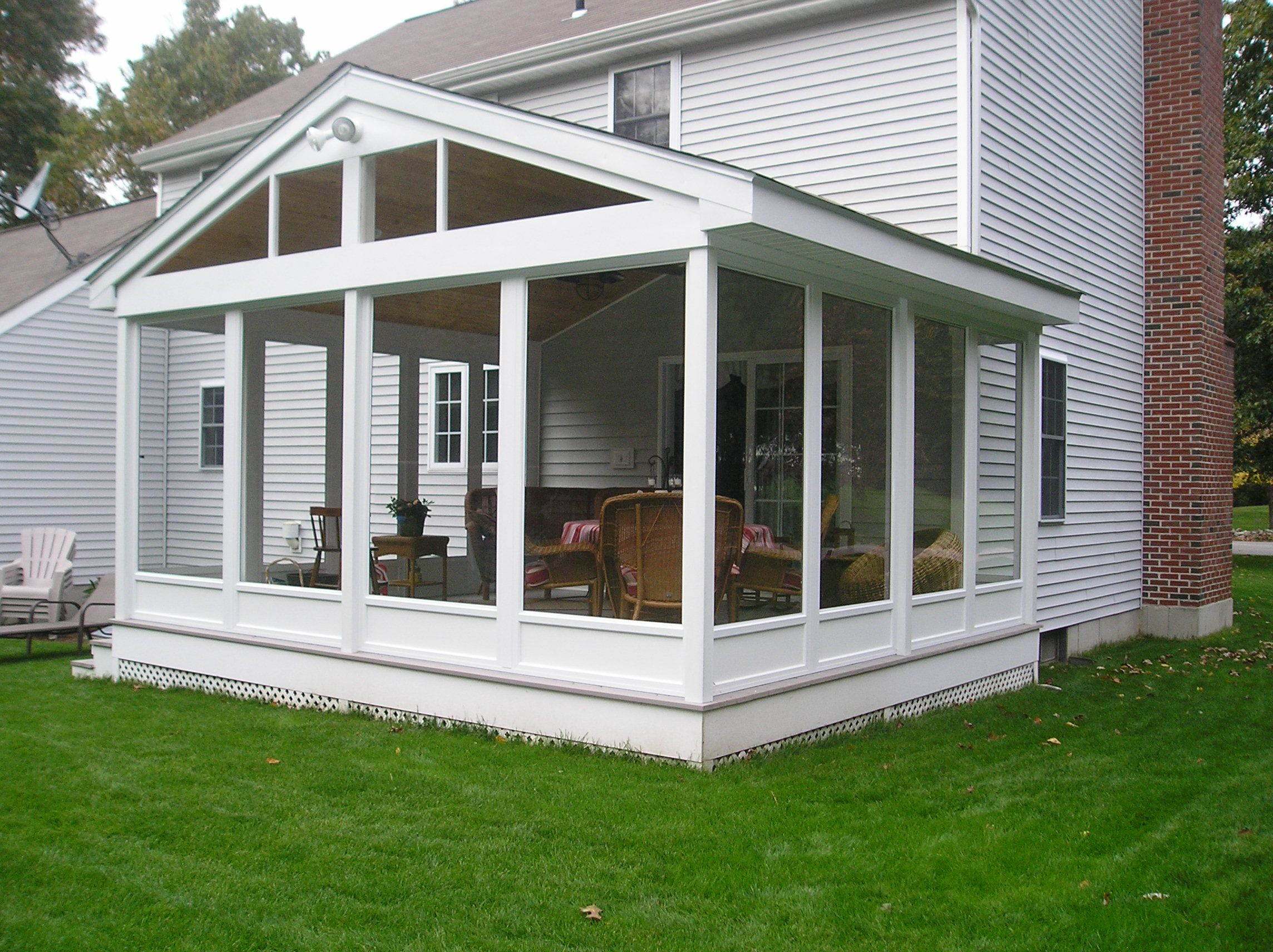 Screen porch enclosures enjoy a screen porch year round for Backyard sunroom