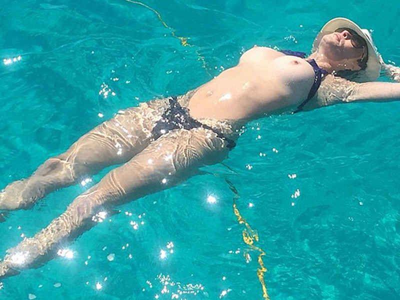 Photo of mature woman braless