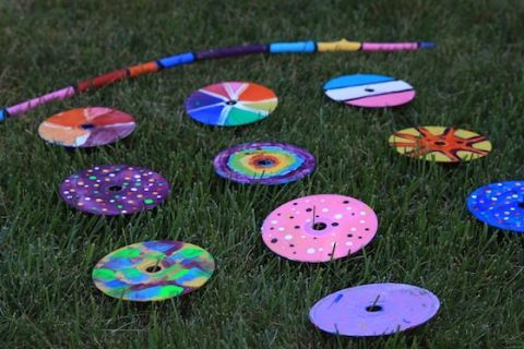 Painted CD Garden Mobile is part of garden Art Projects For Kids - Great collaborative project for art class or craft camp! Kids can paint their own unique CDs and string them together to make a colourful mobile for the yard!