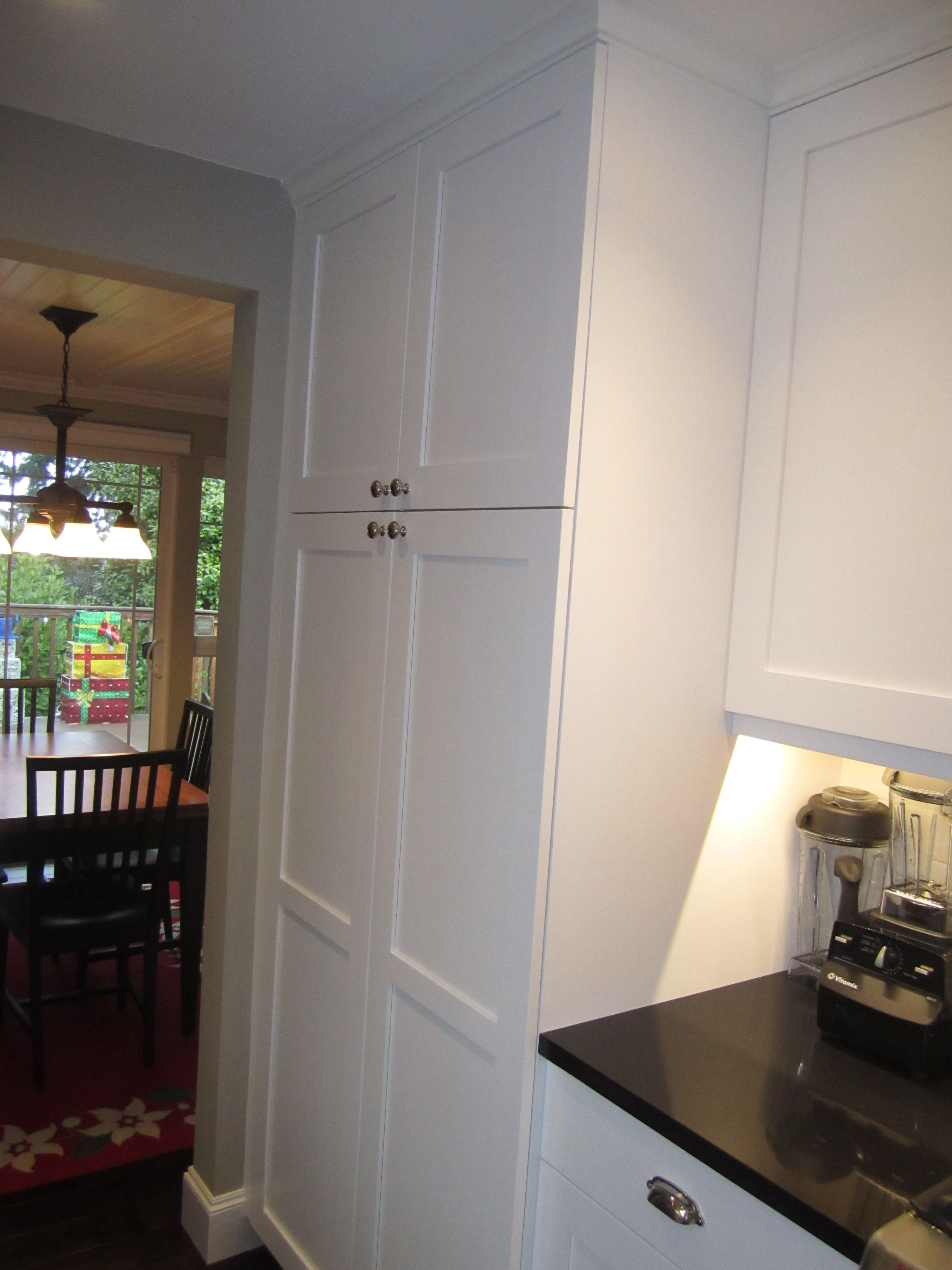 Floor to ceiling pantry with pull out shelves. (former