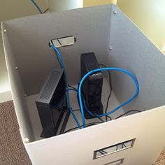 Hide modems, routers, cords, etc in a storage box - duh ...