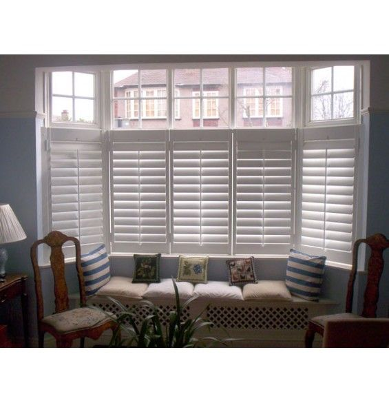 Cafe Style Bay Plantation Shutter And Built In Window Seat