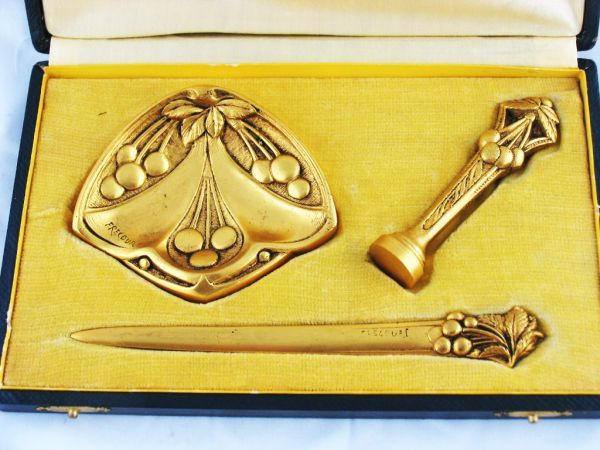 A beautiful, French, three piece, Art Nouveau, gilded bronze desk set comprising letter knife, seal and pin tray. Signed by the sculptor, Frecourt.