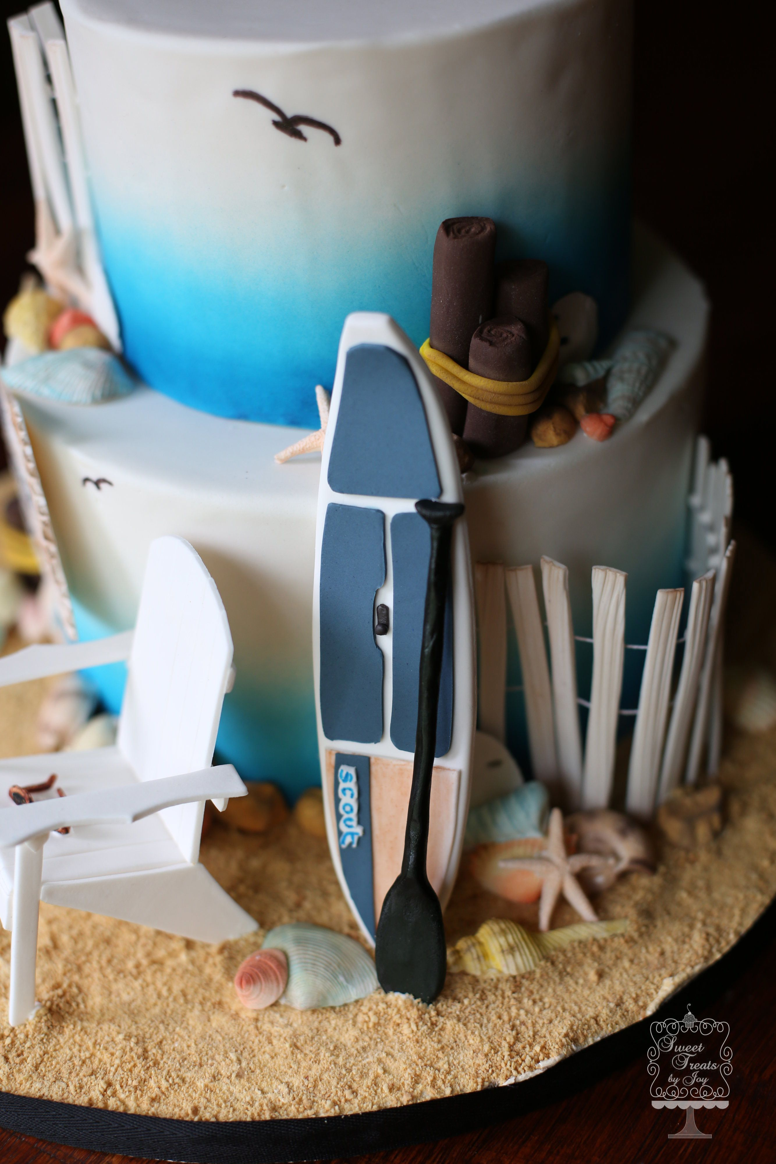 Beach cake with paddle board and Adirondack chair All made by