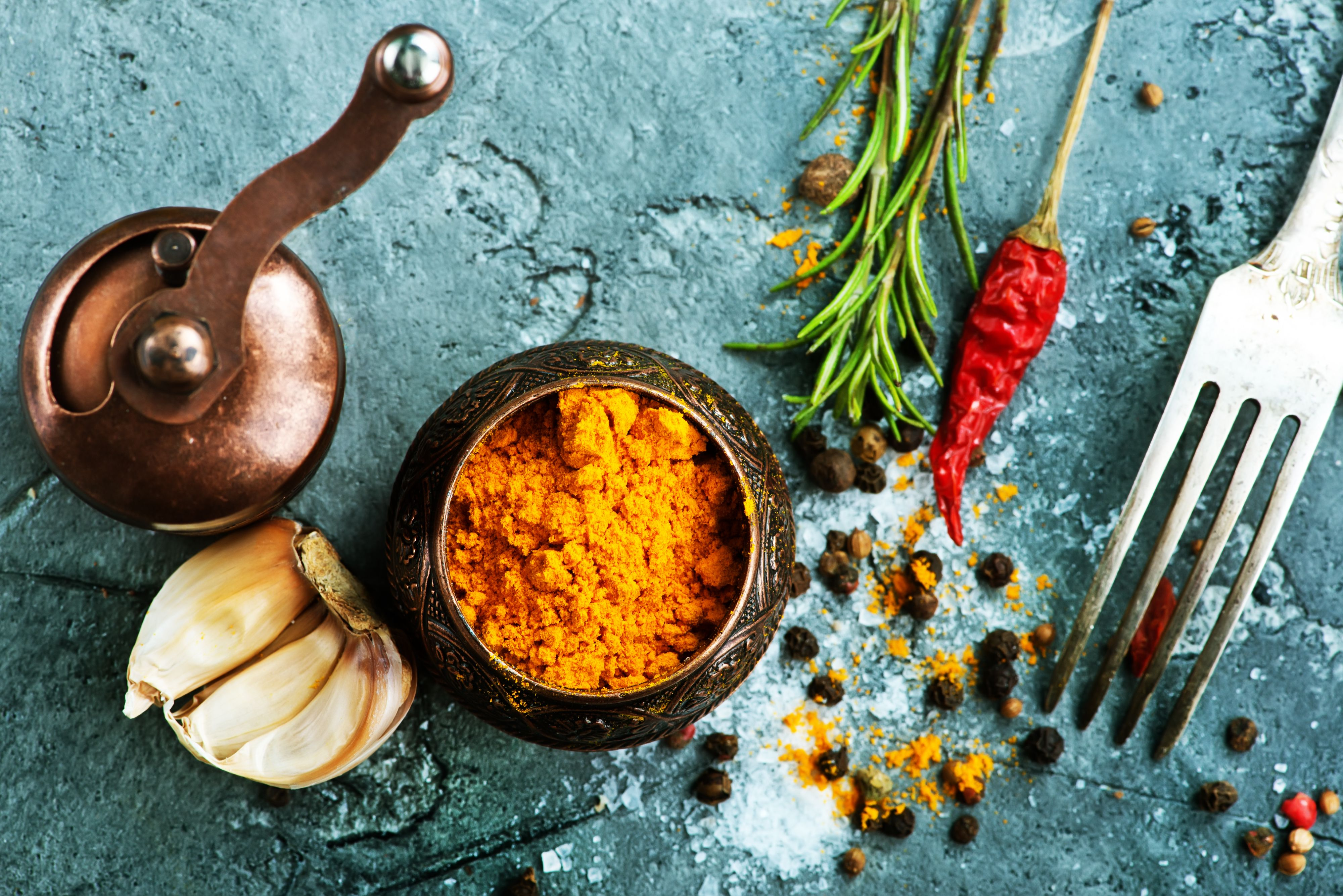 Turmeric and other spices with spice grinder & fork. | Flavorful ...