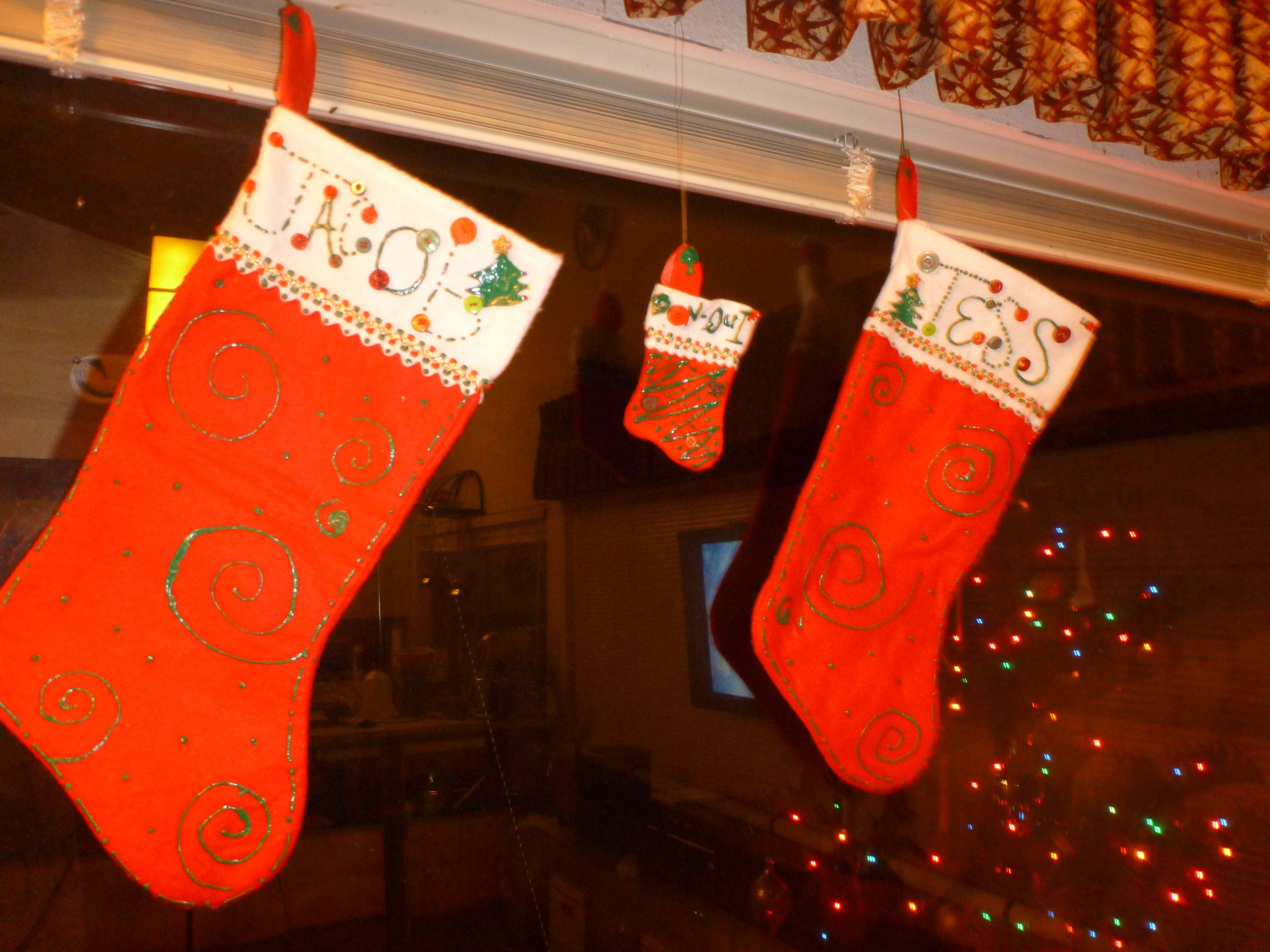 Decorated Christmas Stockings With A Little Fabric Paint And Some
