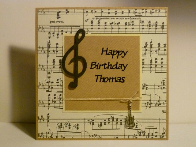 Musical themed card using real sheets of music and guitar charm
