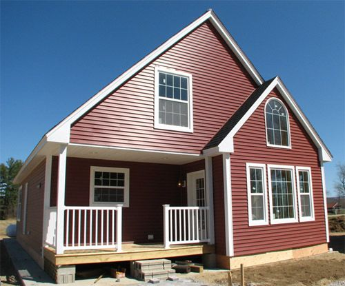 Small Manufactured Home With Dark Red Wall