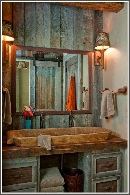 I don't know how practical a wooden sink would be but I love the sliding barn door for the shower (look in the mirror).