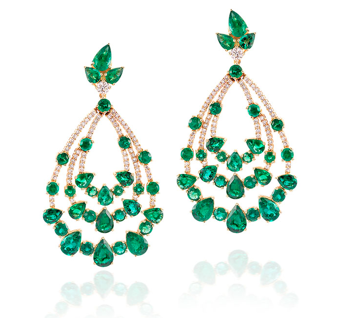 Octium bespoke gold earrings created in collaboration with Gemfields, featuring emeralds and diamonds (POA).