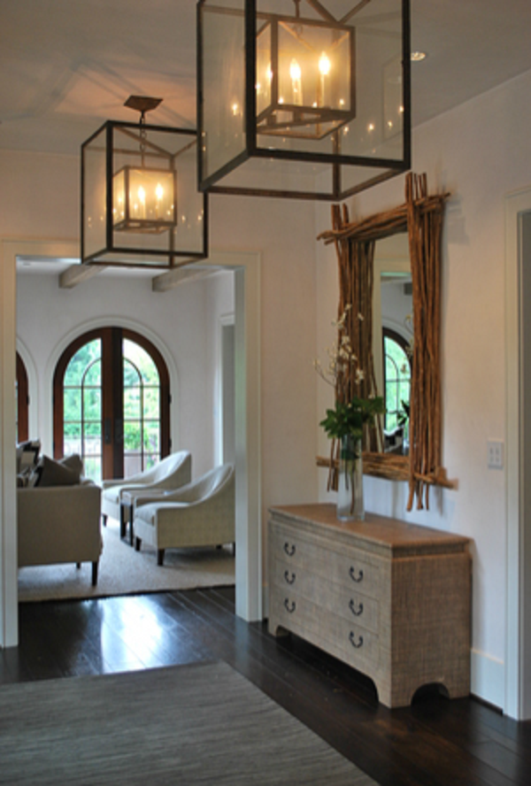 New traditional a clean architectural white foyer with - Lighting ideas for halls and foyers ...