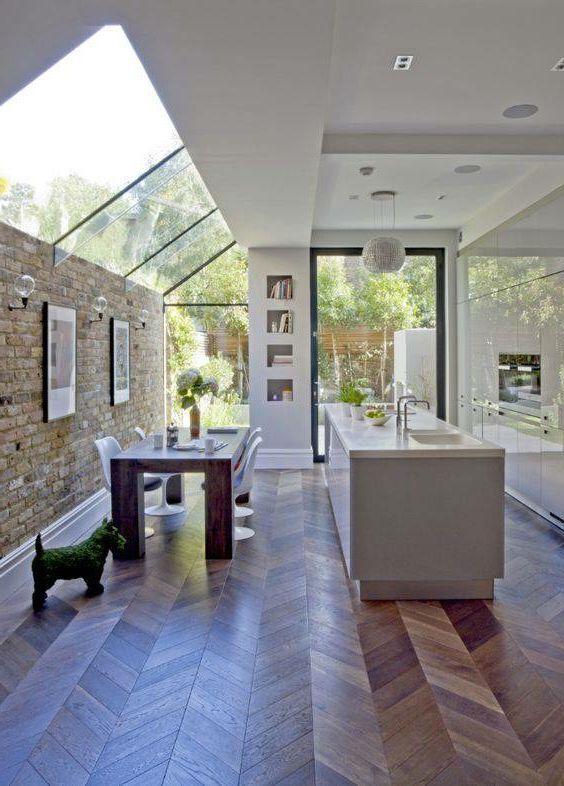 Beautiful space with custom skylight feature and herringbone wood flooring #inte #homeextensions