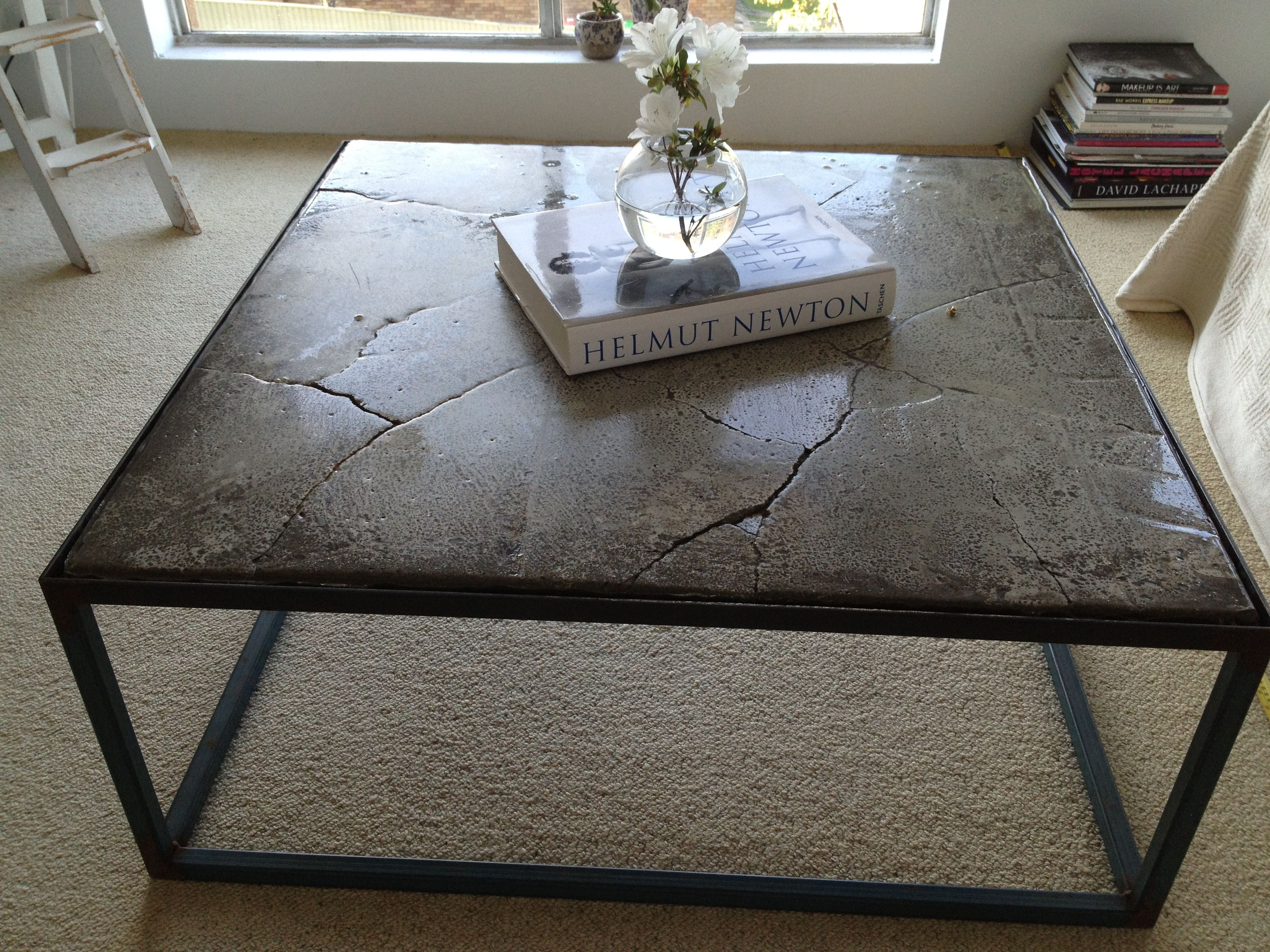 Cracked concrete resin filled coffee table just moved into our