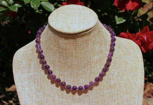 "This Amethyst Gemstone Beaded Necklace is 12"" long. Amethyst is the Birthstone for February. This necklace is hand knotted next to each bead, to ensure safety for small children in case the necklace w"