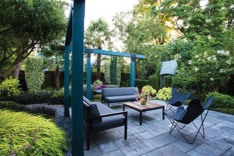 Lauren Hall Behrens Garden In Northeast Portland Fuses Modern Industrial Elements With A Backyard Garden Design Tropical Garden Design Small Backyard Gardens