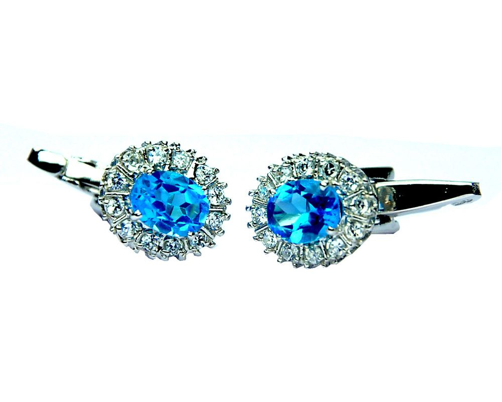 925 Sterling silver stud earrings with natural faceted Blue Topaz gemstones