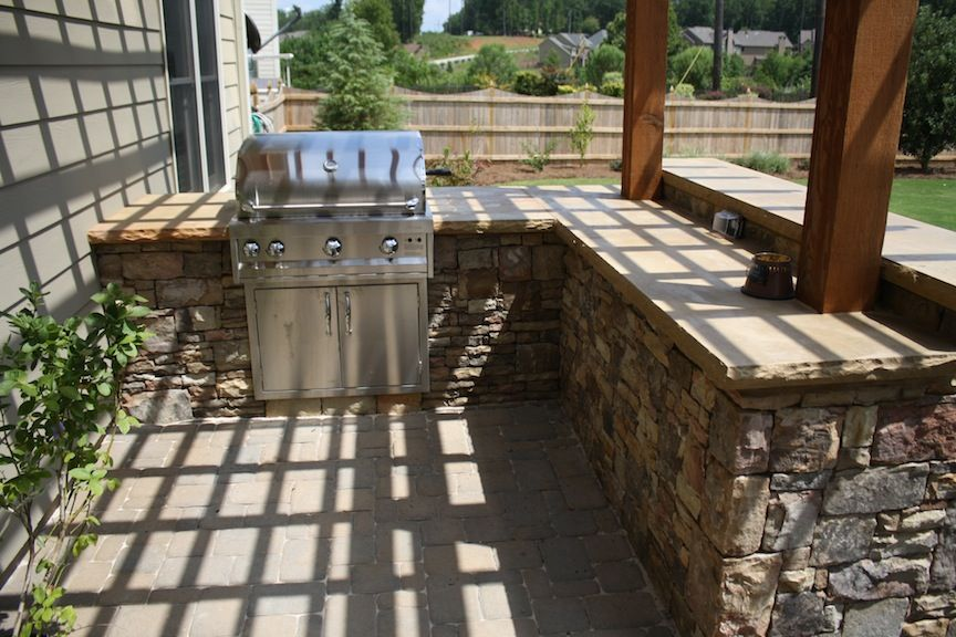 Stacked stone l shaped outdoor kitchen with attached for L shaped pergola