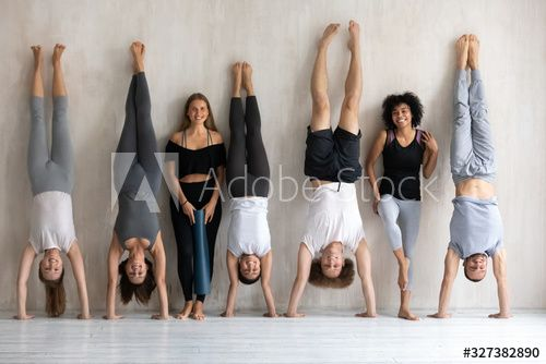 Multiethnic strong sportive people in sportswear standing posing near wall - Buy this stock photo and explore similar images at Adobe Stock