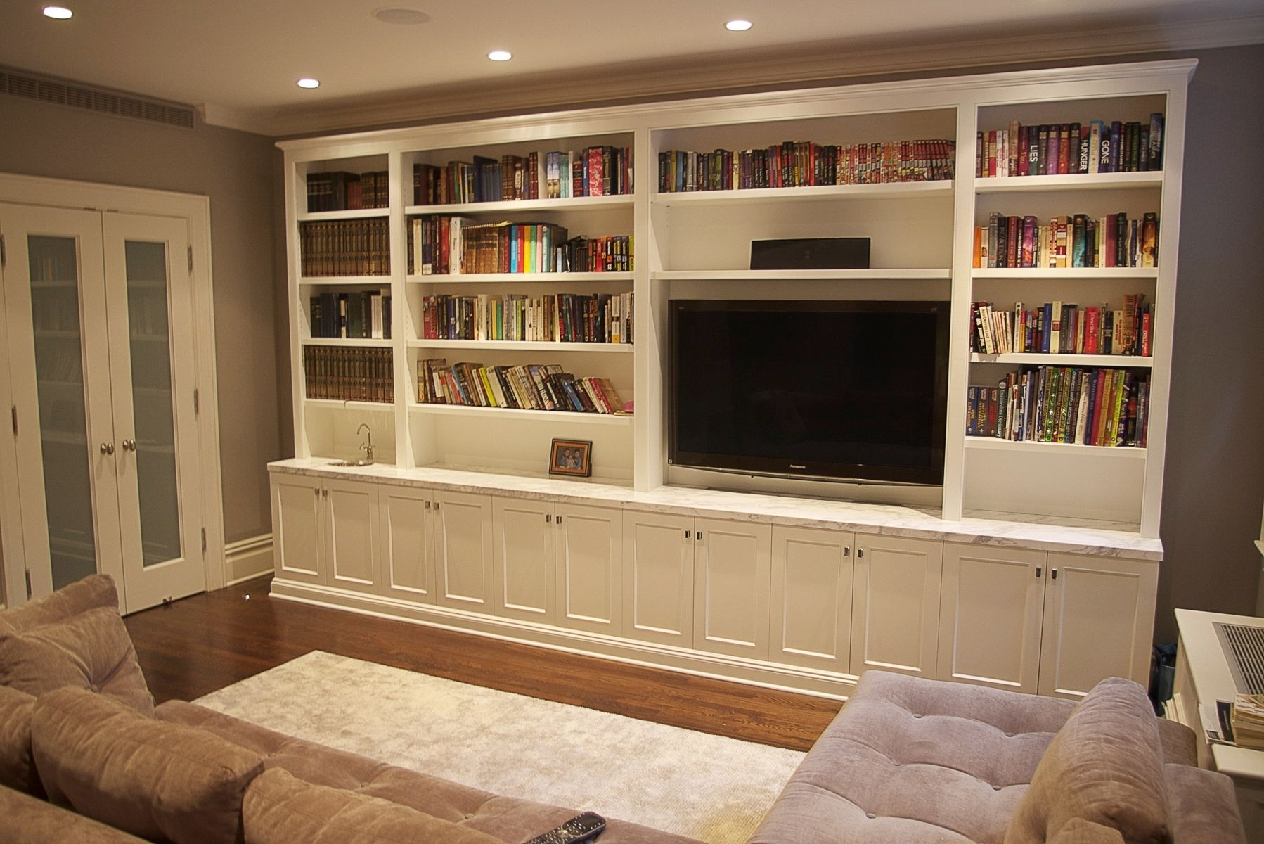 Pin On House Sitting Room Custom built in cabinets for living room