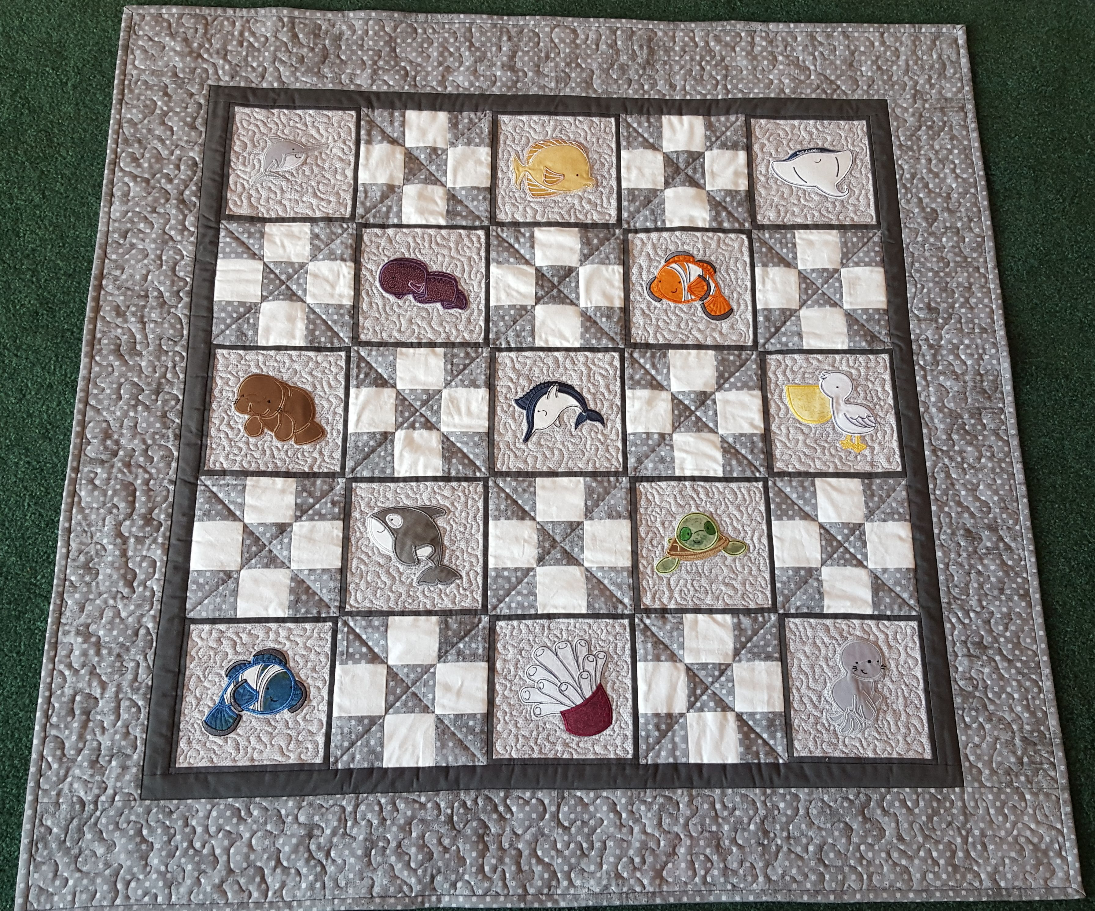 Jeanette made this striking quilt using designs from Sea Creatures Too Applique (http://www.bunnycup.com/embroidery/design/SeaCreaturesTooApplique).