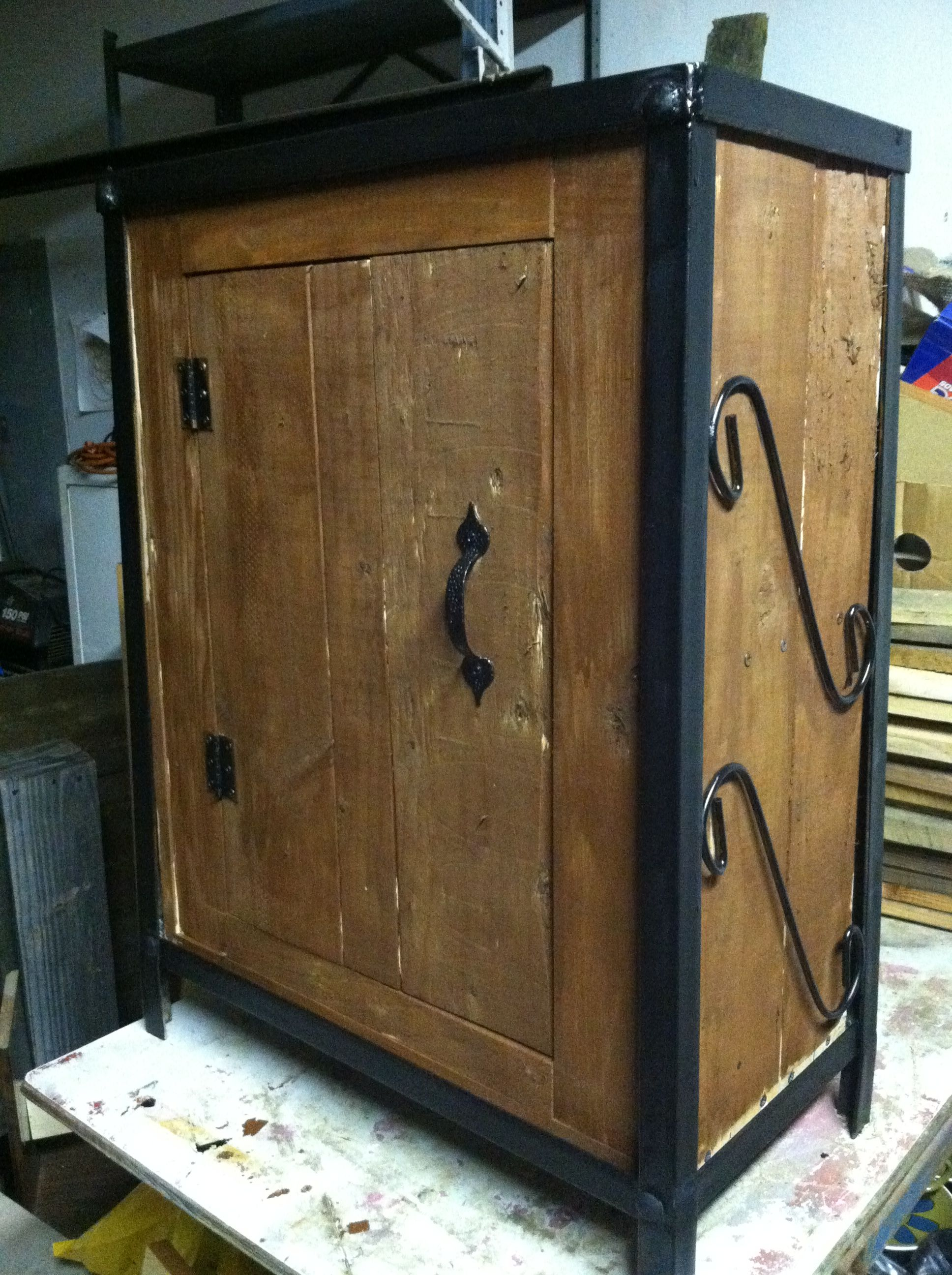 Old wood pallets used as cabinet with old fish tank stand as metal