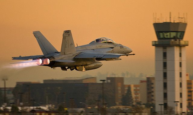 Full-throttle flyby on afterburner by a U.S. Navy McDonnell-Douglas FA-18 Hornet.