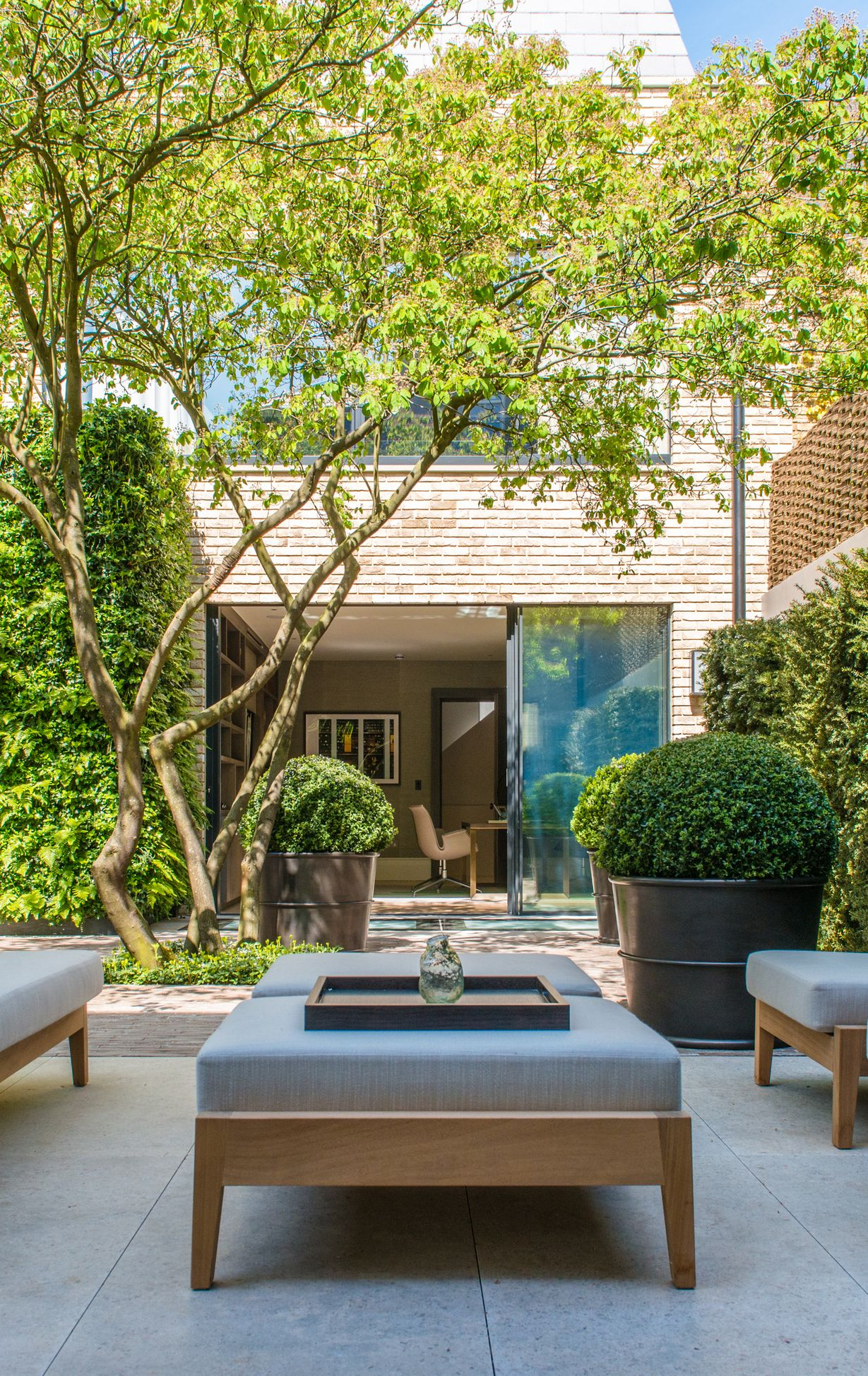 contemporary garden spaces serene sun house | Serene courtyard beyond home extension with glazed sliding ...
