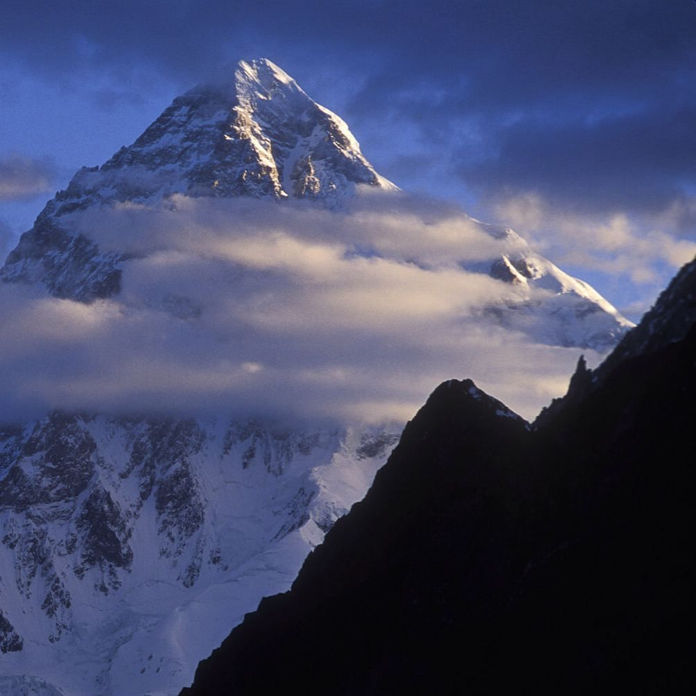 Morning light on K2 in the heart of the mighty Karakoram Himalayas in Paskitan. Shot during my 1994 trek up the Baltoro Glacier. In order to reach my vantage point at sunrise and capture this image I woke up at 3:00 AM and hiked for over an hour over very rocky terrain towards Concordia which is the confluence of the Baltoro Glacier and the Goldwin-Austin Glacier. Although I was still two years away from turing pro this trip remains one of the greatest photographic experiences of my life…
