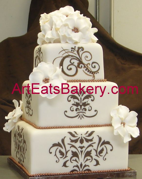 Three Tier Square Ivory Fondant Custom Wedding Cake With Brown Designs And White Flowers