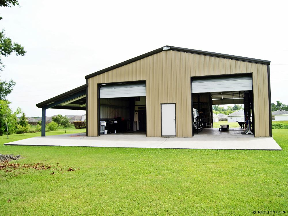 steel garage building with two high overhead doors and a lean to on the side - Metal Building Design Ideas