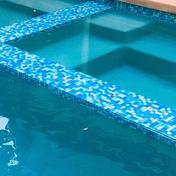 Wishing for a dip in this mid mod pool right now. It's tiled in our Brio glass Mosaic blend Cabo. A mix of cool aqua blues with pops of white and orange. Have a refreshing weekend! #modwalls #moderntile #mosaics #glasstile #pooltile #freshtile #swimmingpool #colorwins #midmodern #coolpool