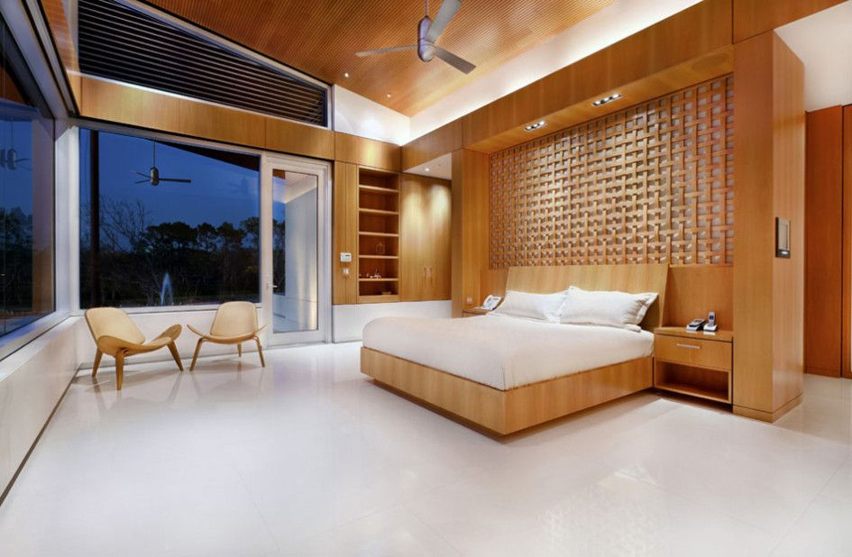 Architecture nice bedroom design with sapcious area using lots wooden materials to furnishing and decoration