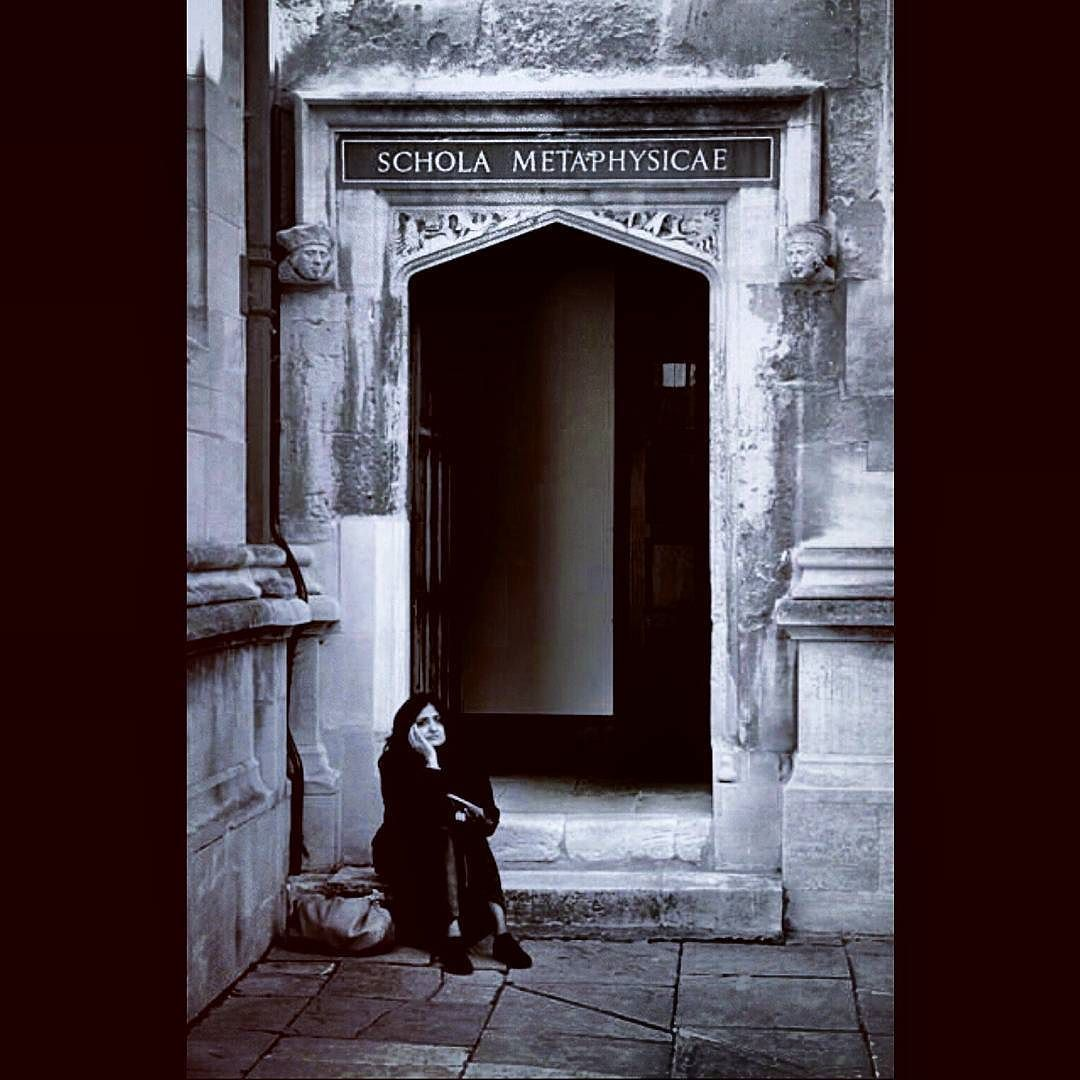 When metaphysics has got you feeling down. #philosophyproblems  A candid shot taken at the entrance to the schola metaphysicae in the Old Schools Quad of the Bodleian in Oxford.  #streetphotography #oxforduniversity #Oxford #oxfordphotographer #bodleian #metaphysics #philosophy #oldbuildings #candid #blackandwhite #monochrome #mood #pondering #caughtinthought #historic #academia #university #study by noemidreksler.photography