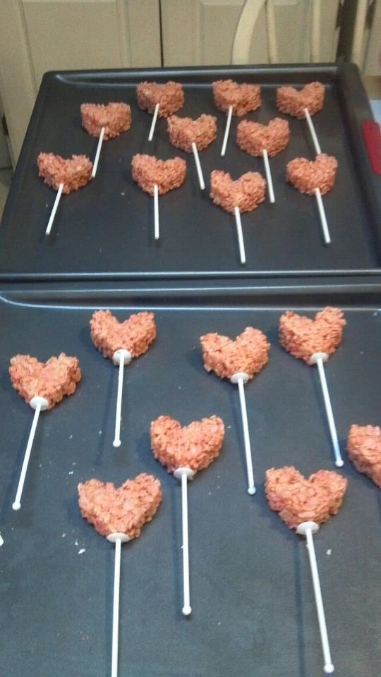 rice crispy treats died light pink....shaped in hearts, put on a stick ~ bf the chocolate